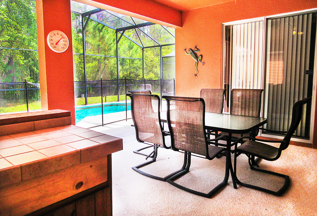 Dine in style with the lanai dining area with outdoor kitchen serving station.