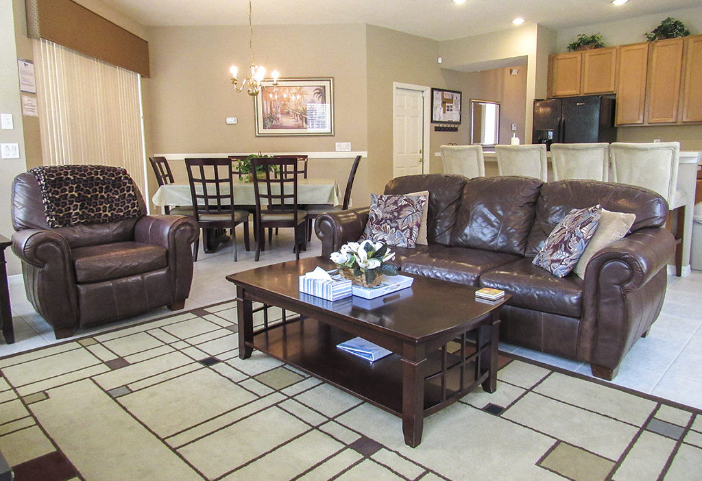 Family room with comfortable leather couch and armchairs.