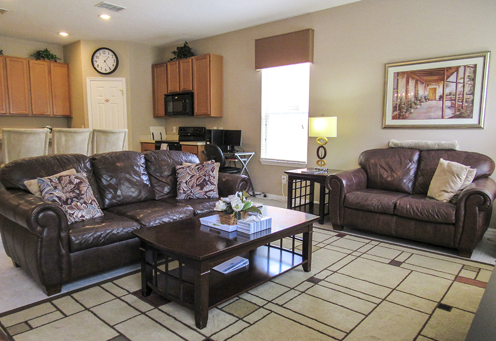 Spacious family room with large flat screen TV.