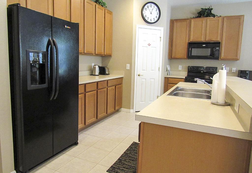 Kitchen has plenty of work surfaces and a large fridge/freezer.