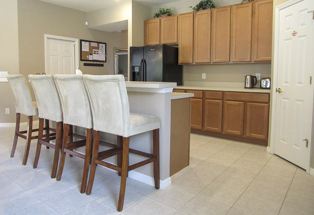Kitchen breakfast bar for additional dining seating.