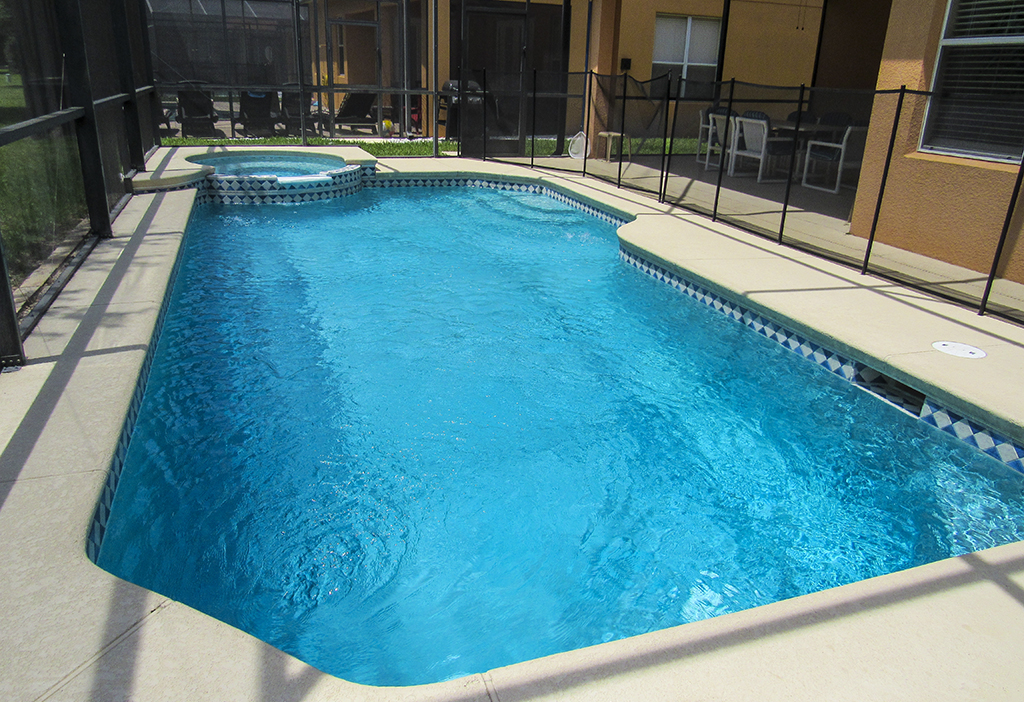 Large private pool has safety fence for your peace of mind.