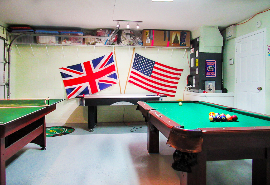 Games room with pool table.