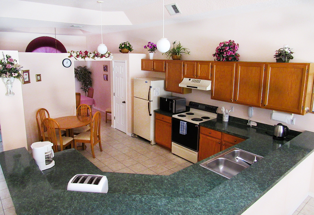 Well equipped kitchen to conveniently serve both dining areas and family room.