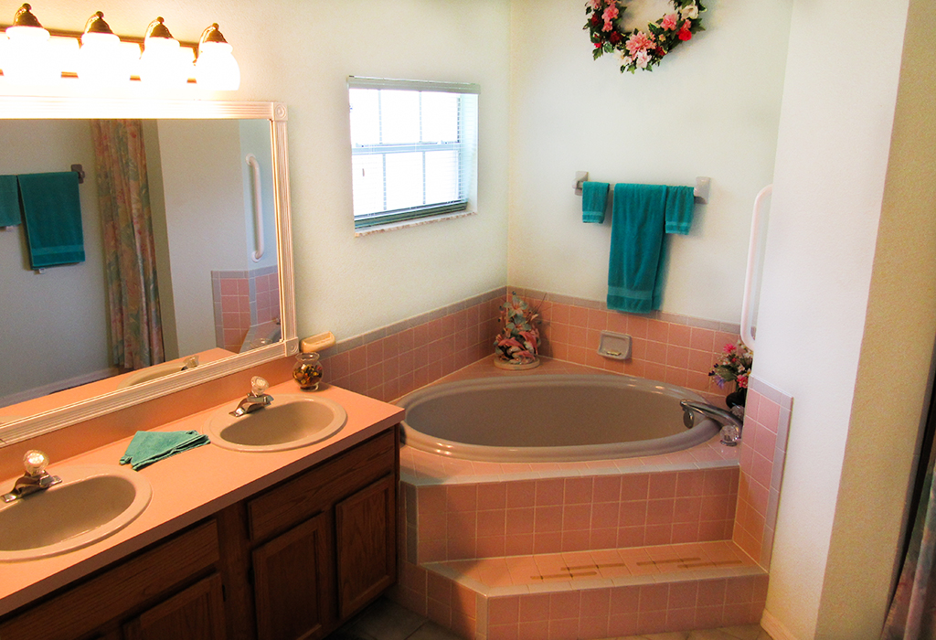 Master bathroom with corner bath, dual sinks and shower.