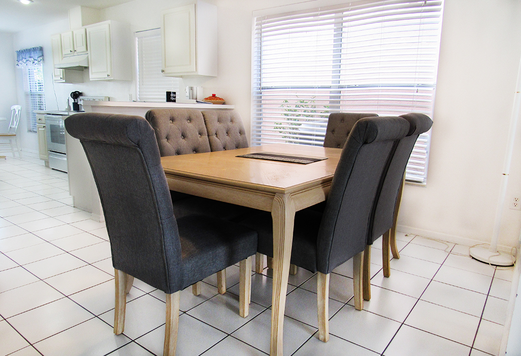Dining room with stylish seating to seat 6.