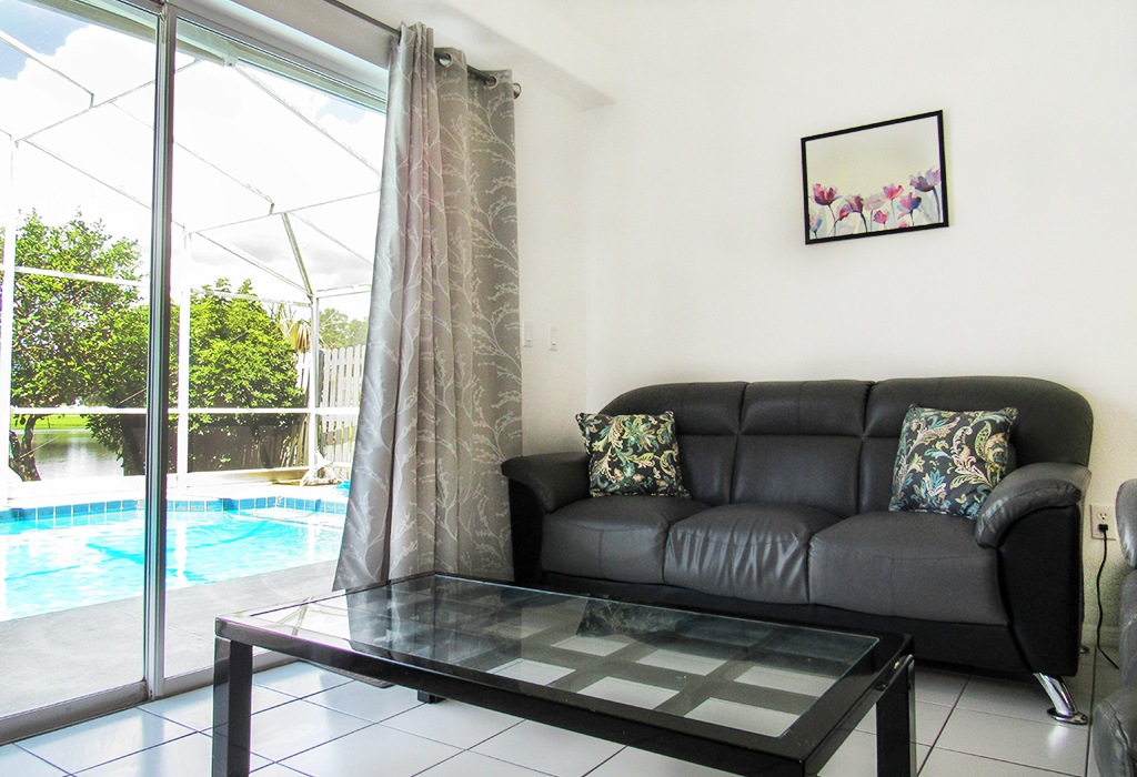 Modern family room, showing great pool view and access.