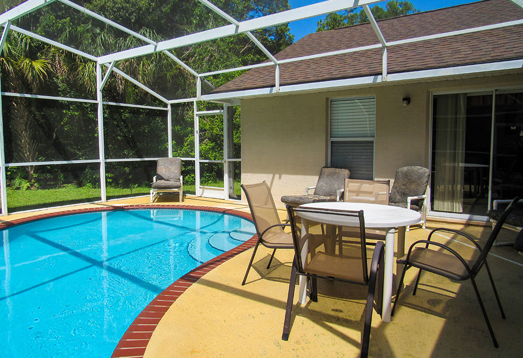 Private pool area with conservation view