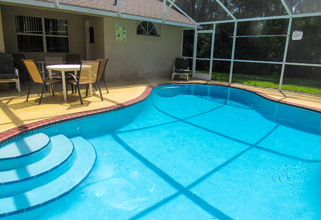 Pool is enclosed with screen for guest comfort and great water quality.