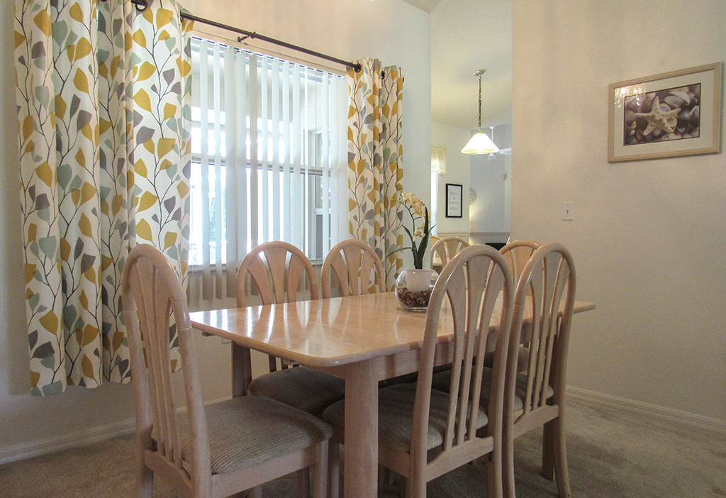 Dining room with plenty of seating for family dining.