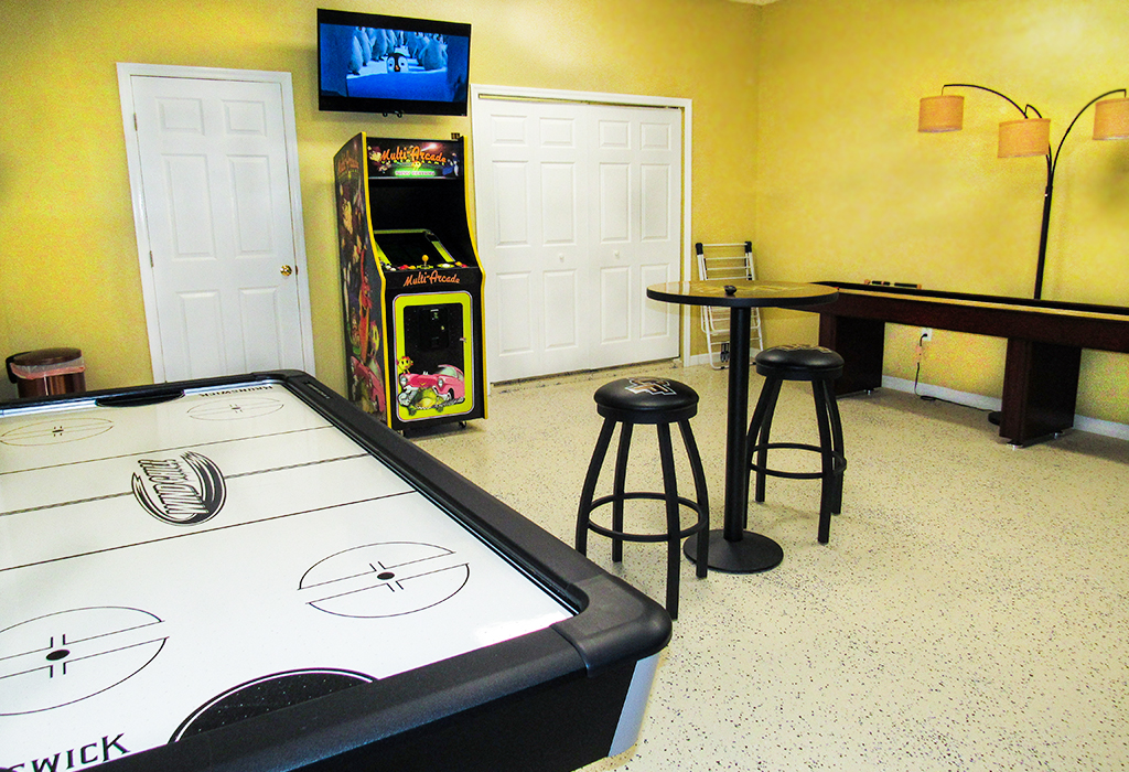Unique games room, featuring; arcade machine, air hockey, and shuffleboard!