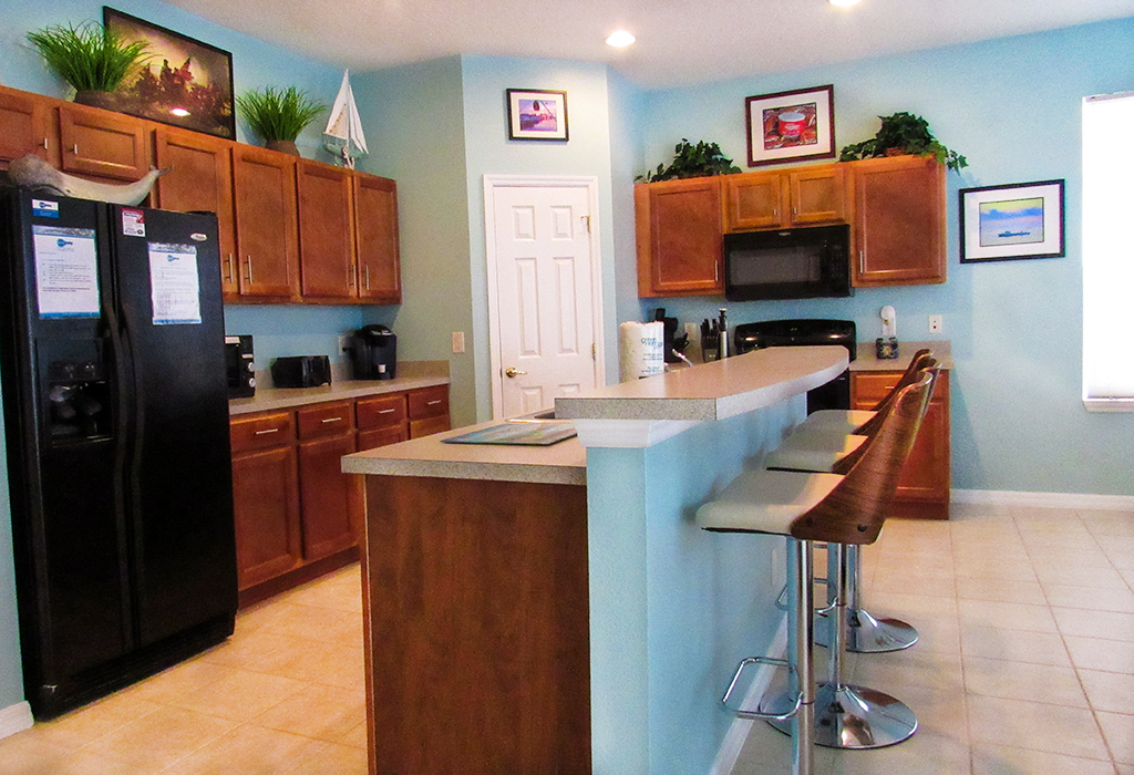 Adequate kitchen space with stylish breakfast bar.