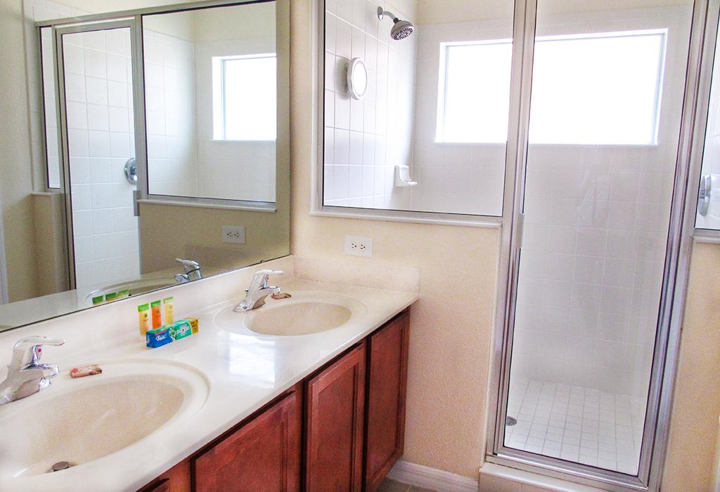 Master bedroom en-suite bathroom with walk in shower and dual sinks.