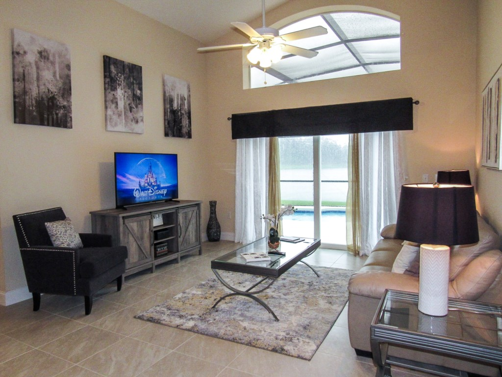 Family room opens out to the lake view pool area.