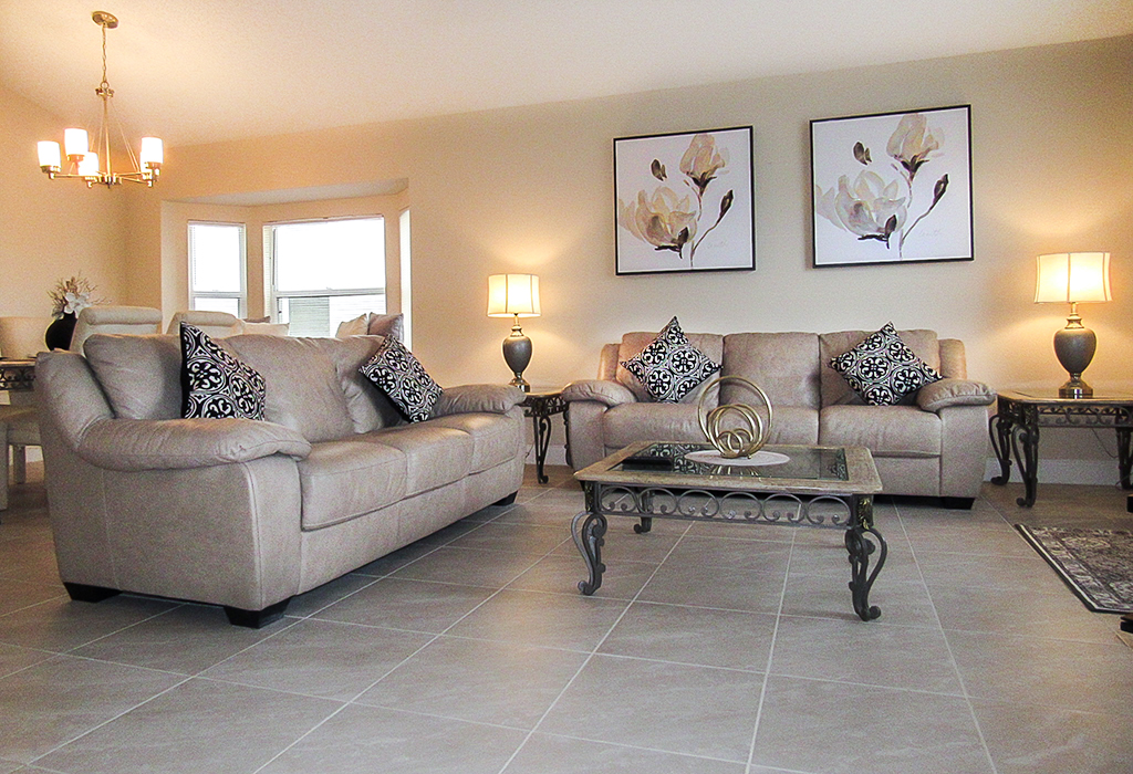 Front living area with comfortable leather couches and smart TV.