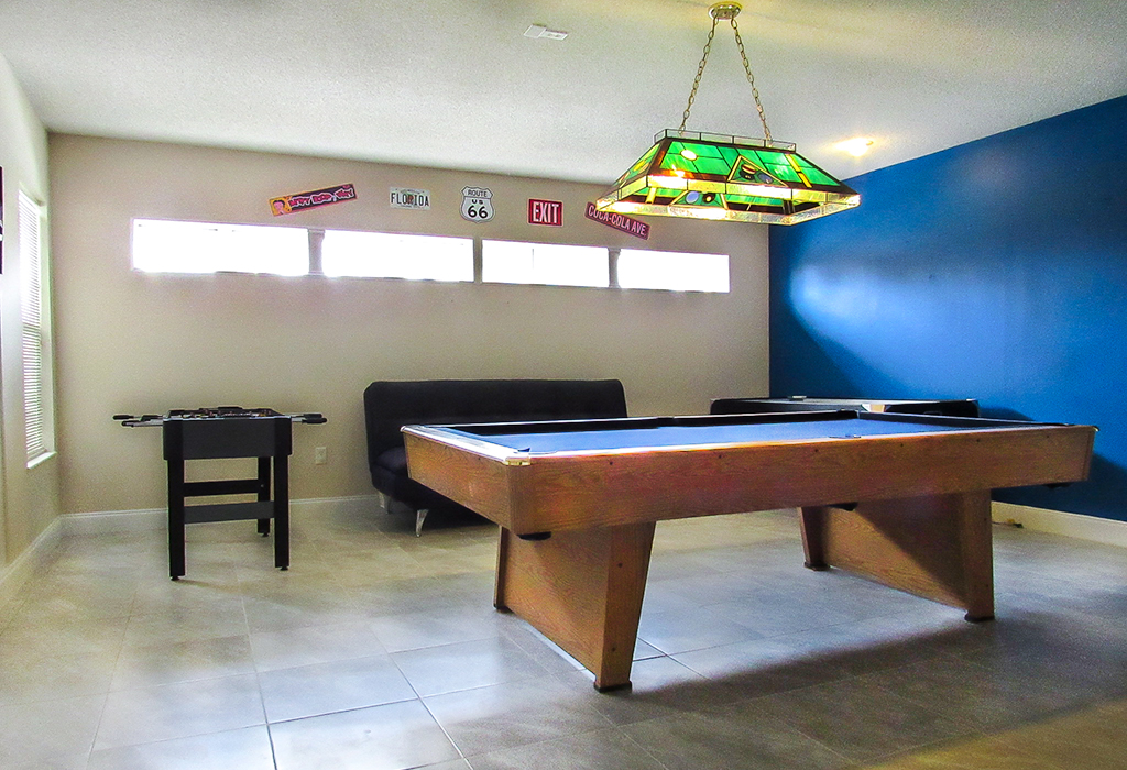 Tiled games room features pool table, air hockey table and foosball table included with your stay.