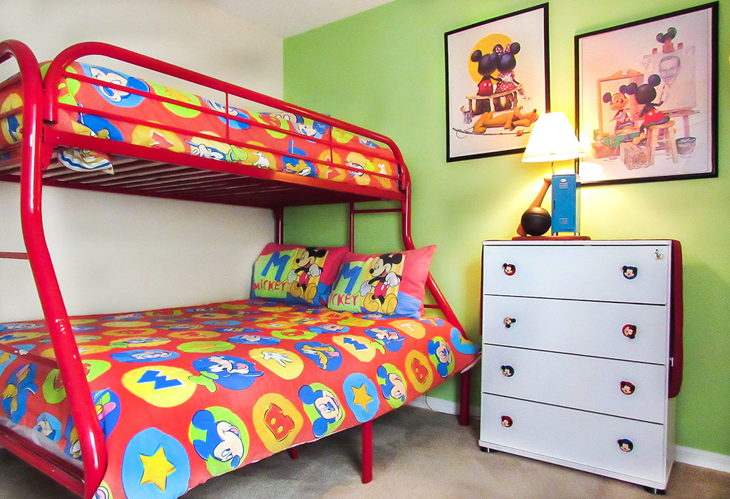 Kids room with full size and twin bunk bed.