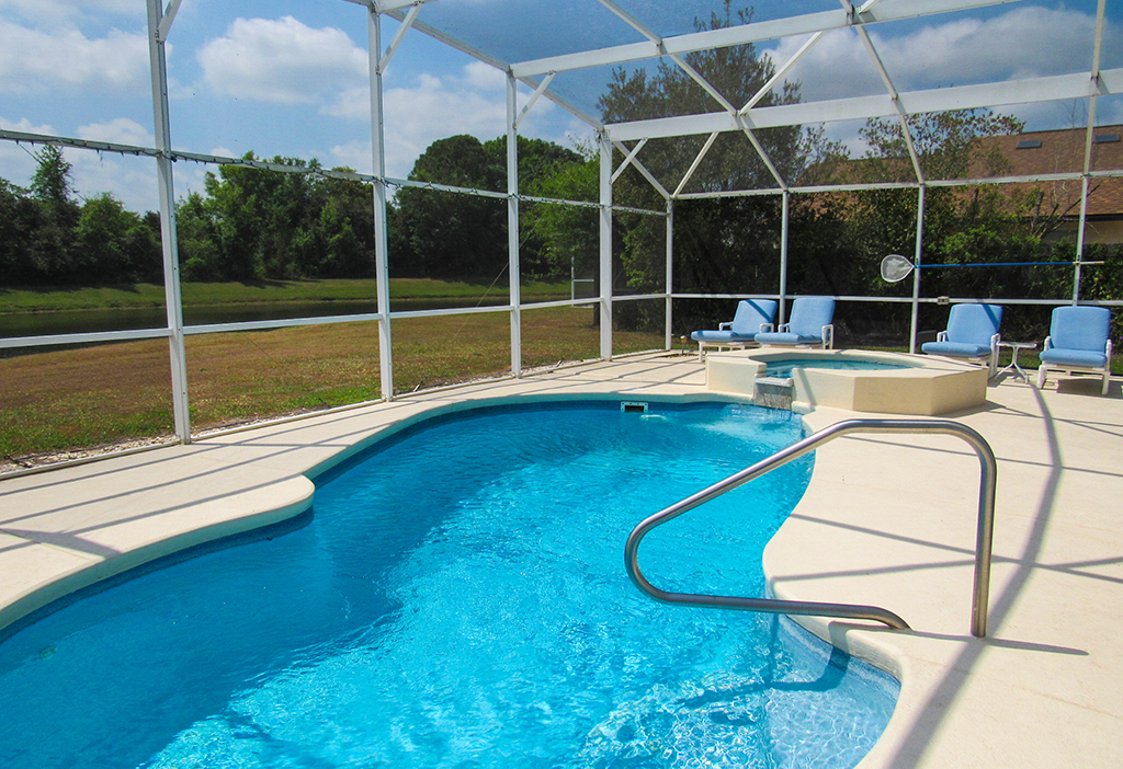 Steps and handrail makes easy access for your dip in the pool.