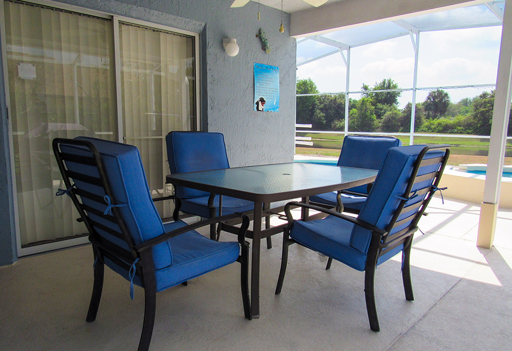 Lanai dining area with gas grill included.