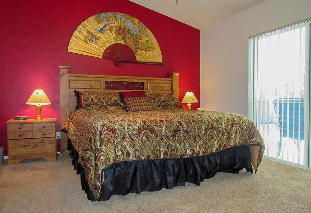 Master suite with king size bed and direct pool access.