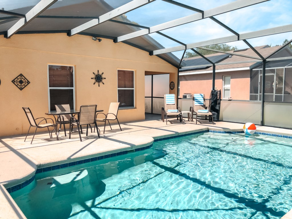 Enjoy al fresco dining or soak up the sun on the two loungers!