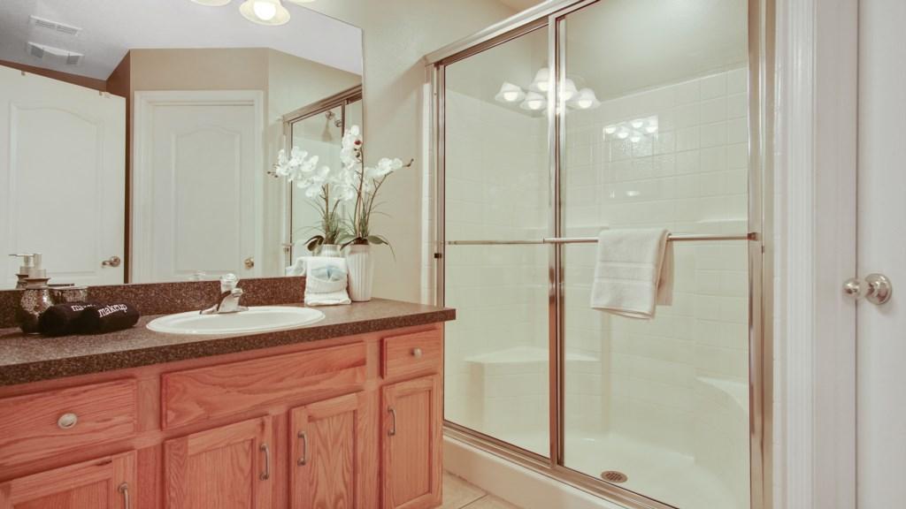 Bathroom 1 - En-suite off Bedroom 1 with walk in shower, sink, toilet, walk in closet