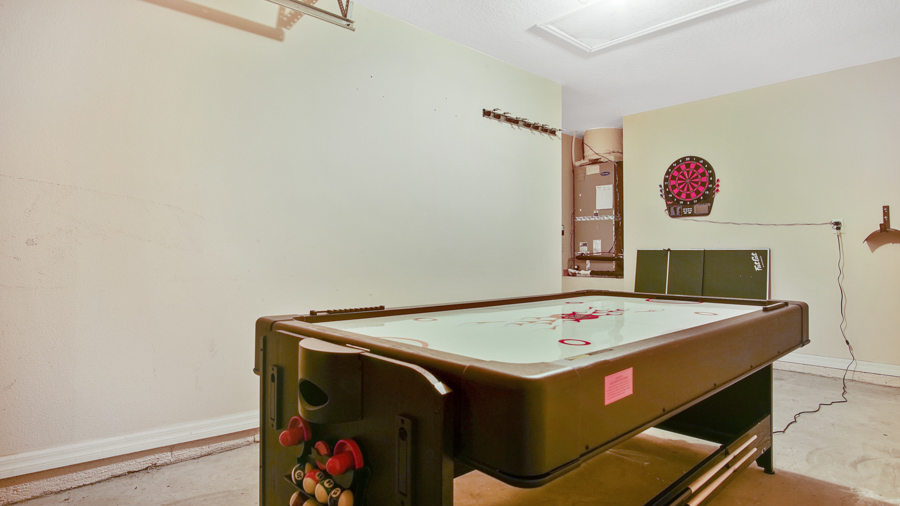 Games Room which has an electronic dart board and a gaming table (for pool, air hockey & ping pong)