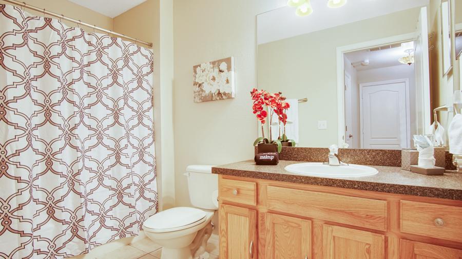 Bathroom 3 - Family bathroom with bath/shower combo, sink, toilet