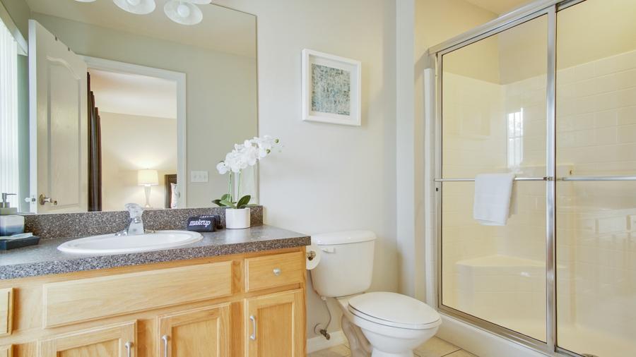 Bathroom 2 - En-suite off Bedroom 2 with walk in shower, sink, toilet, hair dryer