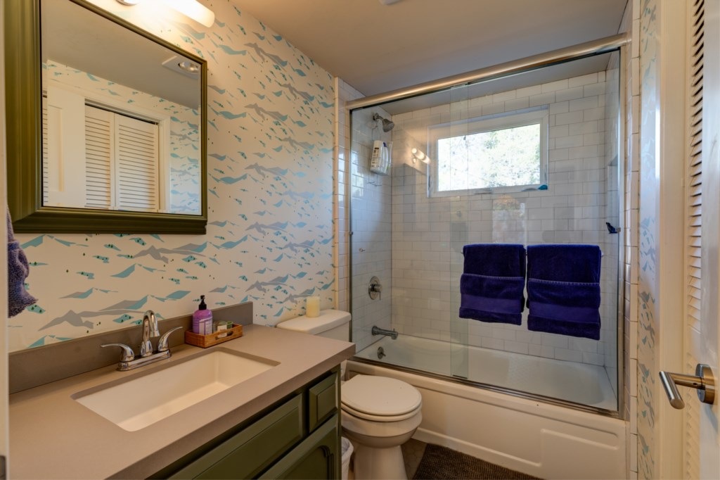 Designer features throughout including wallpaper in Bathrooms