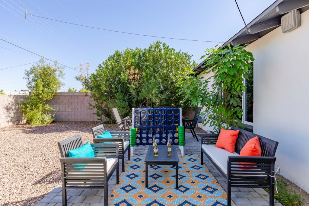 Private backyard with multiple seating areas and giant connect four!