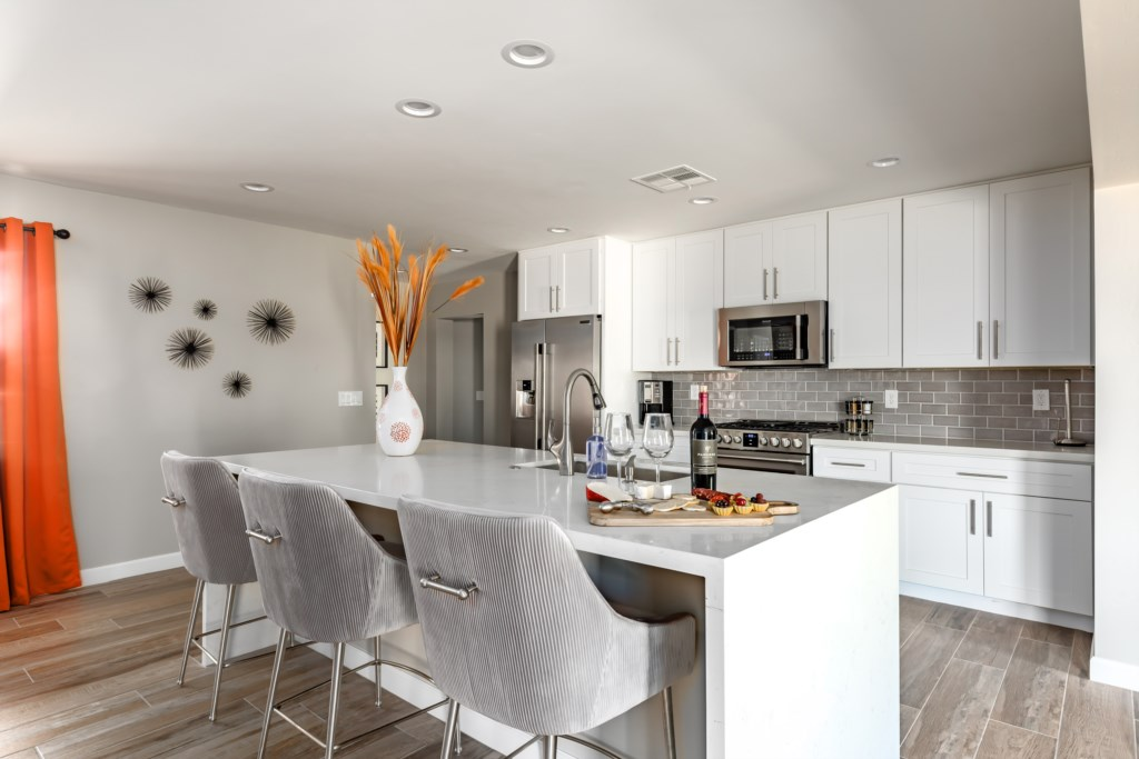 Brand new kitchen with stainless steel appliances and stocked with all cooking essentials