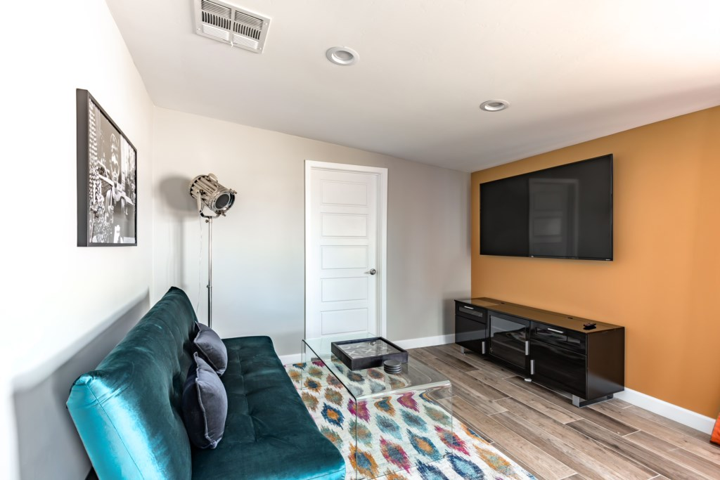 Secondary living room area with large flat screen TV