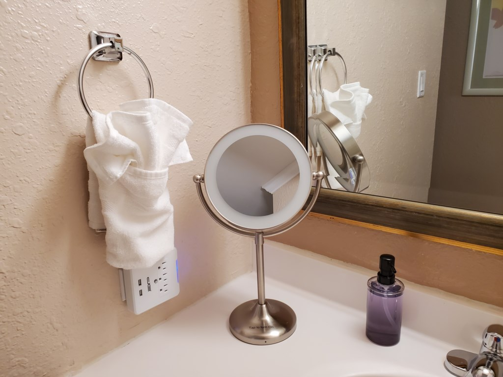 An illluminated make-up mirror is awaiting your personal use