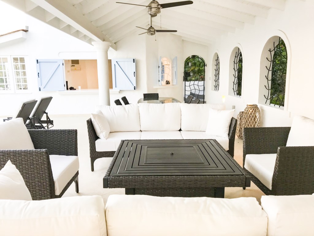 Large covered pool deck, with fire pit and BBQ.