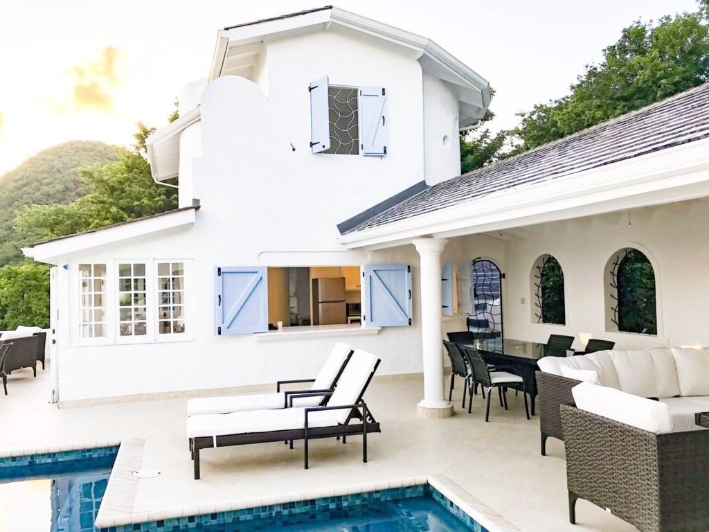 Pool, deck, villa view.
