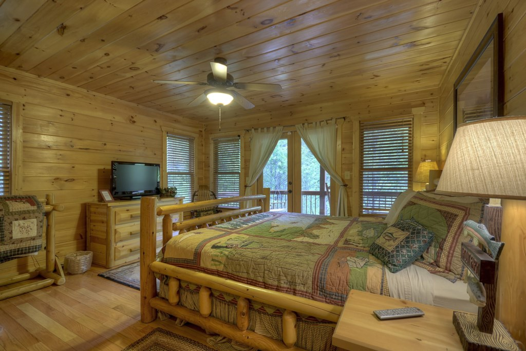 Main level King size bedroom with French doors leading to porch
