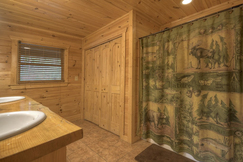 Main level bathroom with washer and dryer in closet