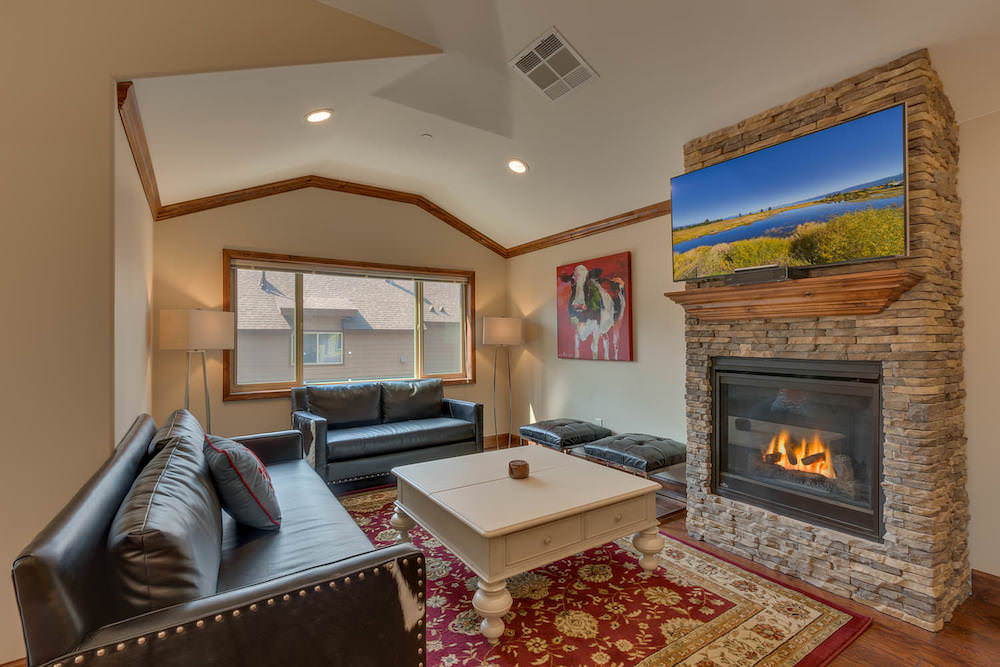 Enjoy the cozy Living space with stone fireplace