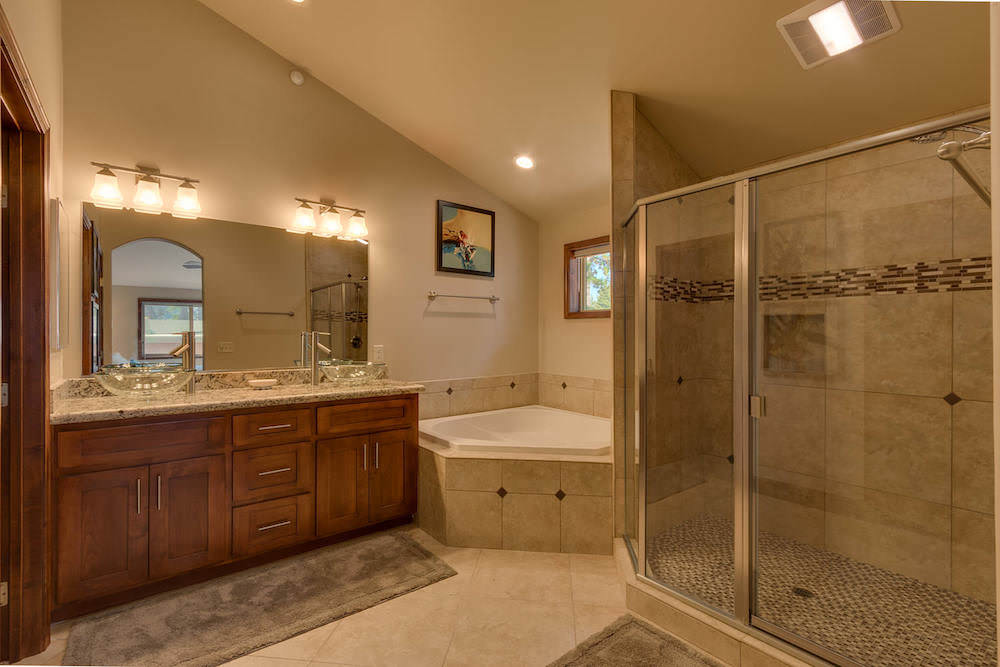 Beautiful Master Bathroom with jetted tub, dual sinks and glass enclosed shower