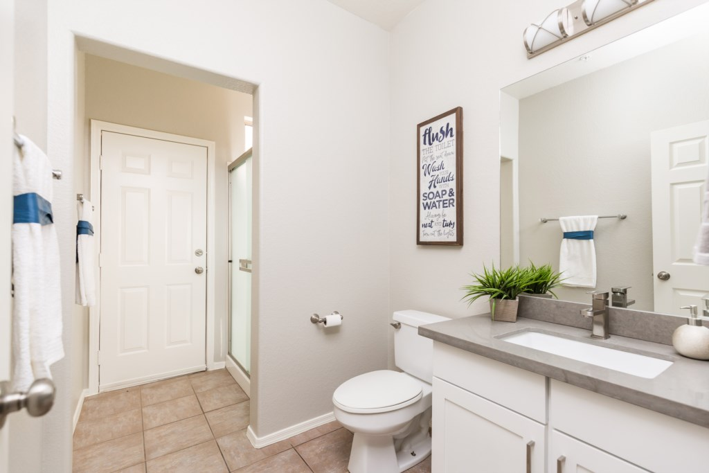3rd Bathroom with large walk-in shower (downstairs shared hallway)