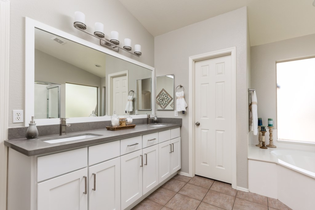 Master Bathroom with double sink vanity, large walk-in shower and huge soaking tub
