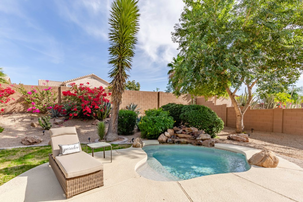 Gorgeous private backyard with seating, lounge chairs, spool, BBQ Grill and Fire Pit