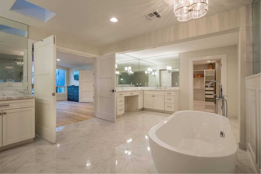 Huge master bath with 15 ft long shower, raised vessel tub, his / her vanities and large closet