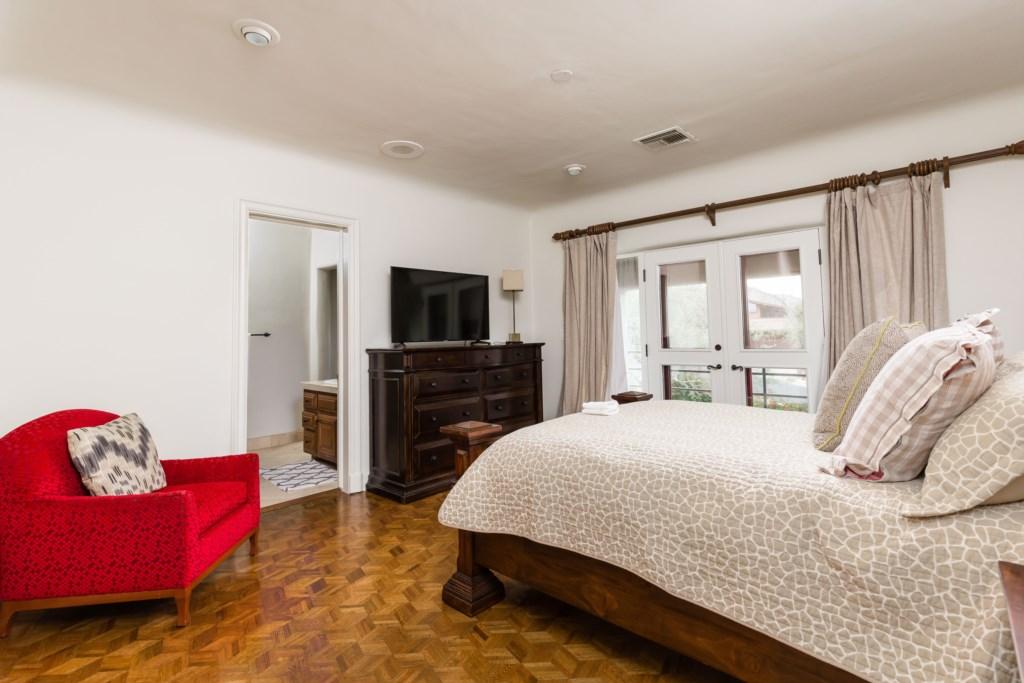 This bedroom has great views and an en-suite bathroom