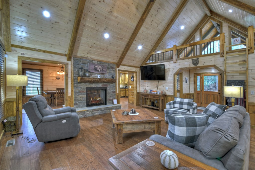 Impressive Living space with fireplace and high vaulted ceilings