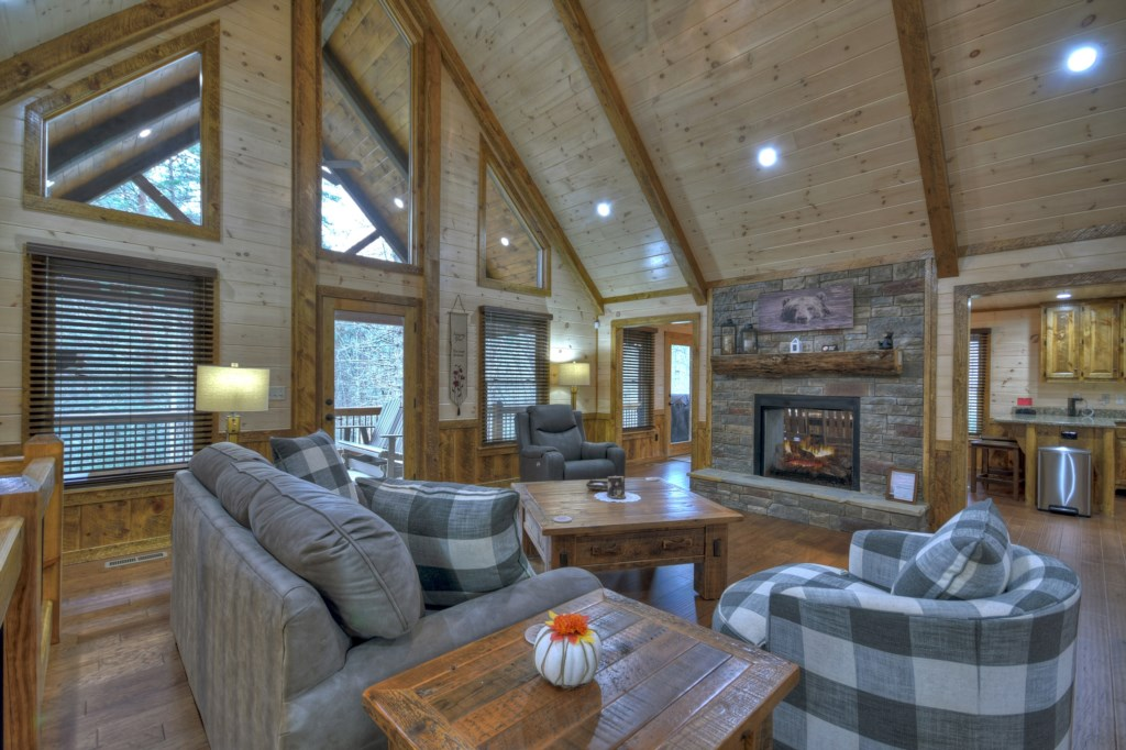 Comfortable and cozy Sitting room with stone fireplace