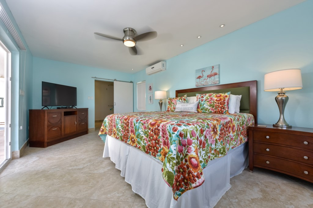 The Master Bedroom with king size bed, walk-in closet, TV and air conditioning and stunning views!