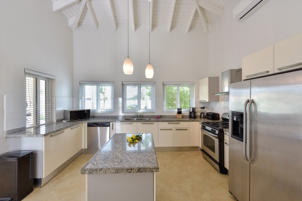 The gourmet kitchen features all appliances and utensils you need for a tremendous meal