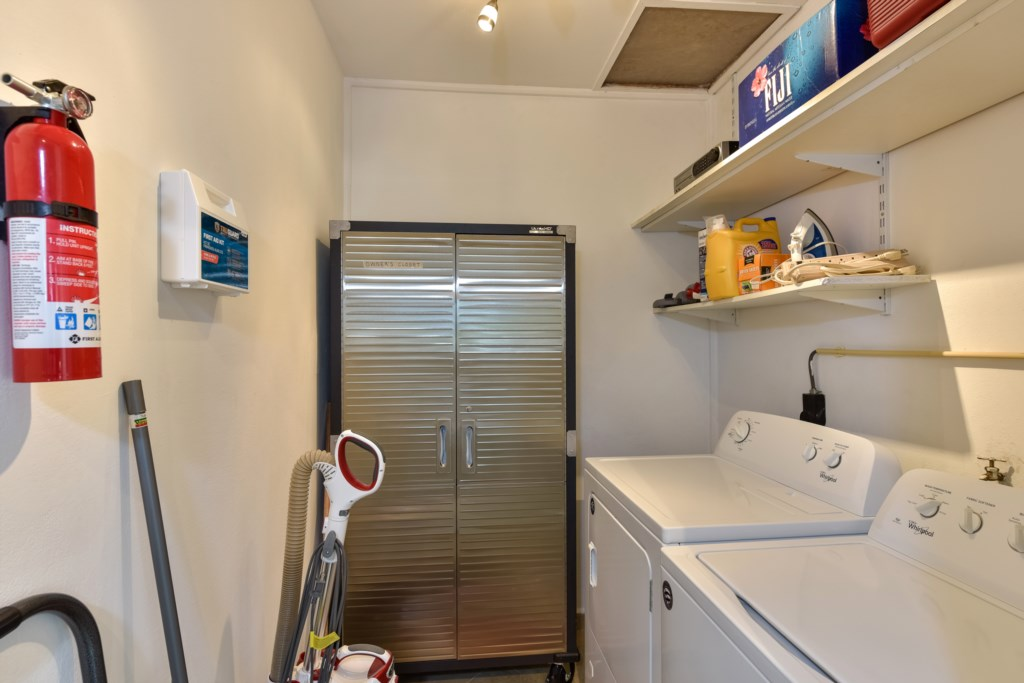 Laundry and storage room, with washer, dryer and iron & board